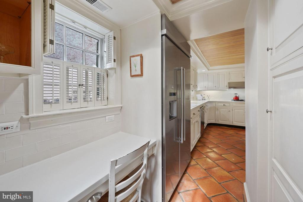Large pantry and a built-in desk in the kitchen - 639 S SAINT ASAPH ST, ALEXANDRIA