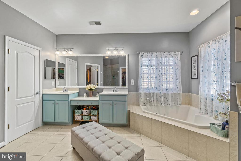 One of two (2) vanities in Primary Bath and Tub - 11924 RICKETTS BATTERY DR, BRISTOW