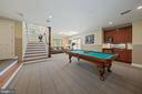Stairs from Great Room lead to Rec/Pool Room - 1901 ALLANWOOD PL, SILVER SPRING