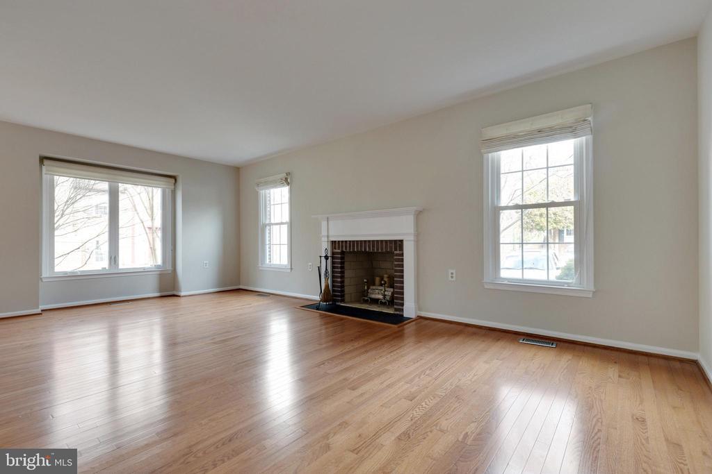 Living Room with Woodburning Fireplace - 11710 COLLINGWOOD CT, WOODBRIDGE