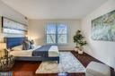 The beautiful hardwood floors extend into bedroom - 2100 LEE HWY #344, ARLINGTON