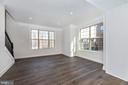 Living Room w/ optional Hardwood - 6626 ACCIPITER DR, NEW MARKET