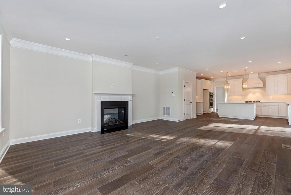 Family Room w/ included Double-Sided Fireplace - 6626 ACCIPITER DR, NEW MARKET