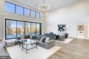 The soaring great room features a wall of glass - 620 RIVERCREST DR, MCLEAN