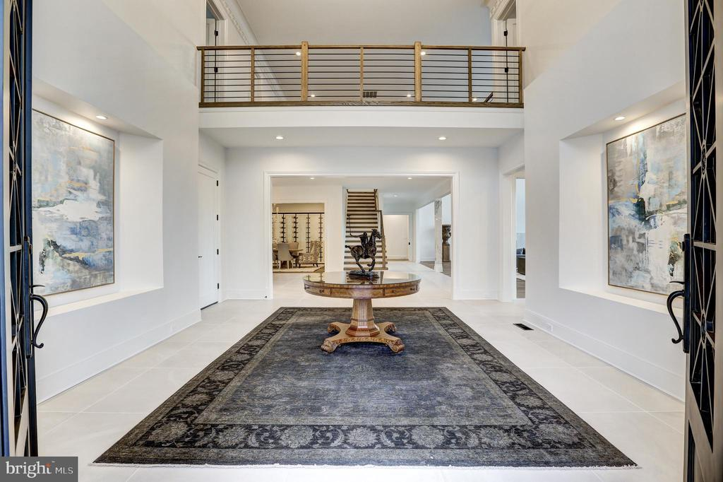 Massive entry doors introduce the entry hall - 620 RIVERCREST DR, MCLEAN
