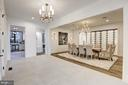 The dining room and dramatic modern wine room - 620 RIVERCREST DR, MCLEAN