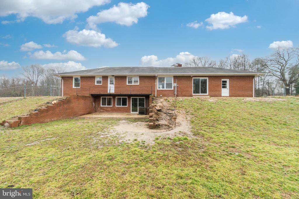 Rear of home with basement entrance - 9035 DAHLGREN RD, KING GEORGE