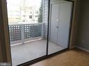 View to patio & storage closet from Living Room - 11705-C SUMMERCHASE CIR #1705-C, RESTON