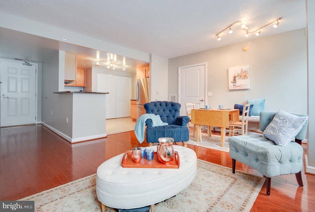 Living room, hardwood floors, new paint soon. - 880 N POLLARD ST #201, ARLINGTON