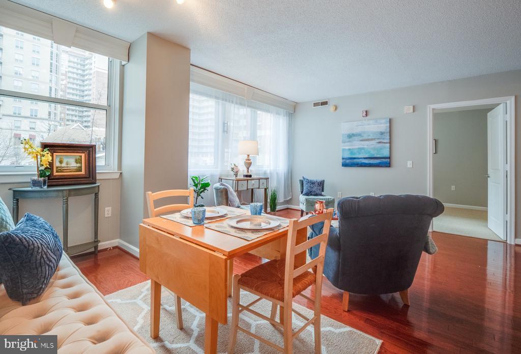 On each side of living/dining room is a bedroom - 880 N POLLARD ST #201, ARLINGTON