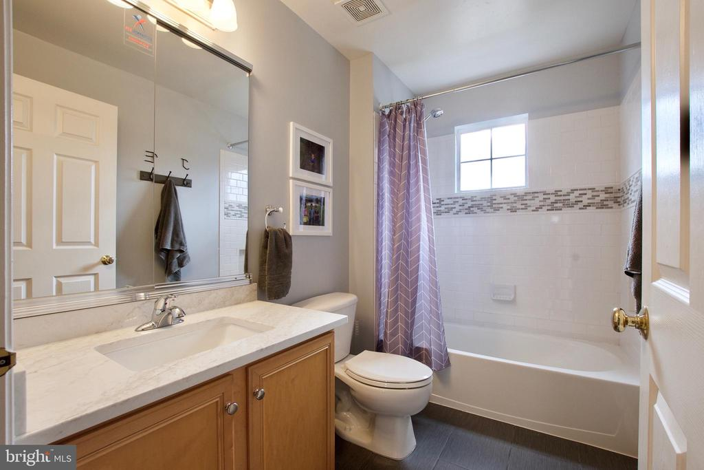 Second bath upstairs has new counter, tile work - 42630 HARRIS ST, CHANTILLY