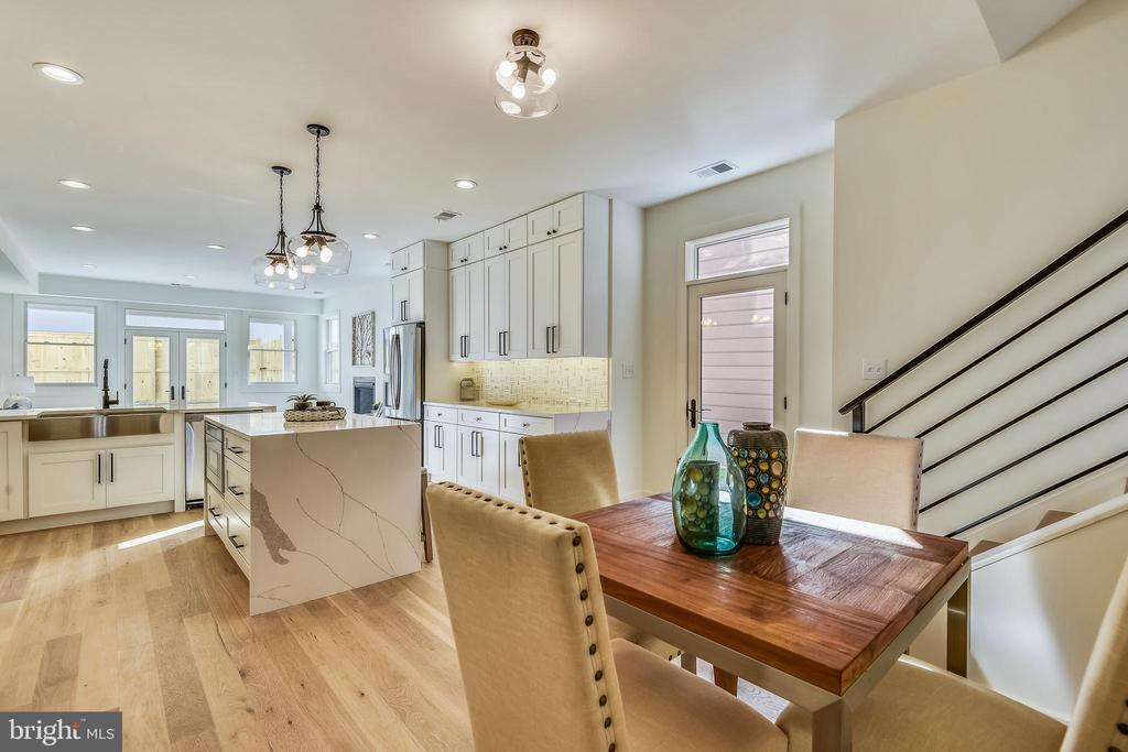 Open Floor Plan into Kitchen and Family Room - 309 N PATRICK ST, ALEXANDRIA