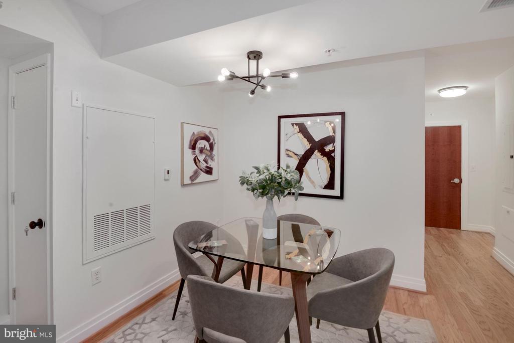 Dining area with new lighting - 915 E ST NW #403, WASHINGTON