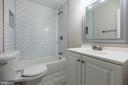 Completely updated main level bath w subway tiling - 7605 LAURALIN PL, SPRINGFIELD