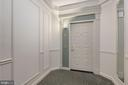 Wide hallway to entrance - 19360 MAGNOLIA GROVE SQ #305, LEESBURG