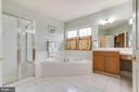 Large master bathroom with separate stall shower - 20277 DAWSON MILL PL, LEESBURG