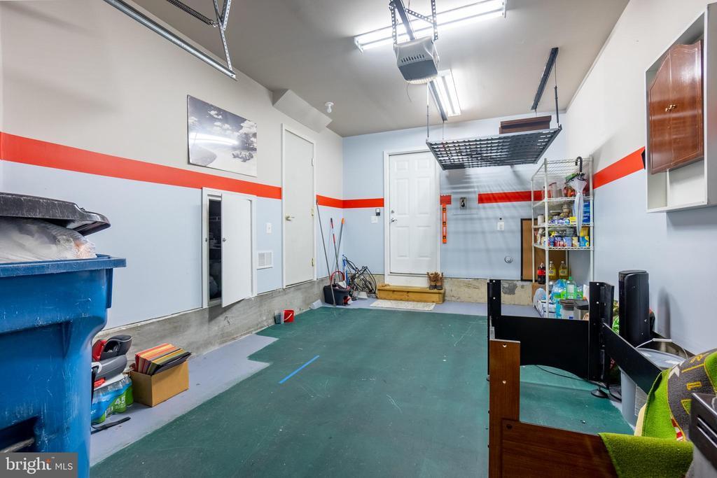 Garage extra storage room with light & Rack up - 22462 FAITH TER, ASHBURN