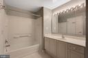 Primary bathroom with additional shower/tub combo - 19365 CYPRESS RIDGE TER #1108, LEESBURG