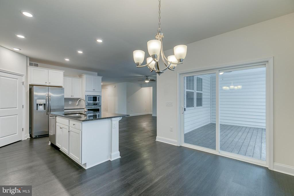 Eat in kitchen with deck . - 103 OLD OAKS CT, STAFFORD