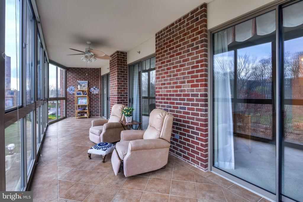 Enclosed porch with floor to ceiling windows - 3100 N LEISURE WORLD BLVD #203, SILVER SPRING