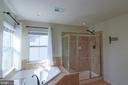 Large soaking tub and tiled shower stall - 1110 HEARTHSTONE DR, FREDERICKSBURG