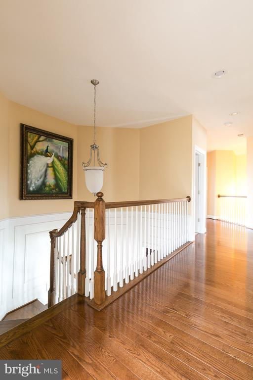Hall way on upper level has hardwood floor too - 21382 FAIRHUNT DR, ASHBURN