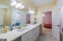 Secondary bath with double vanities - 5615 PICKWICK RD, CENTREVILLE