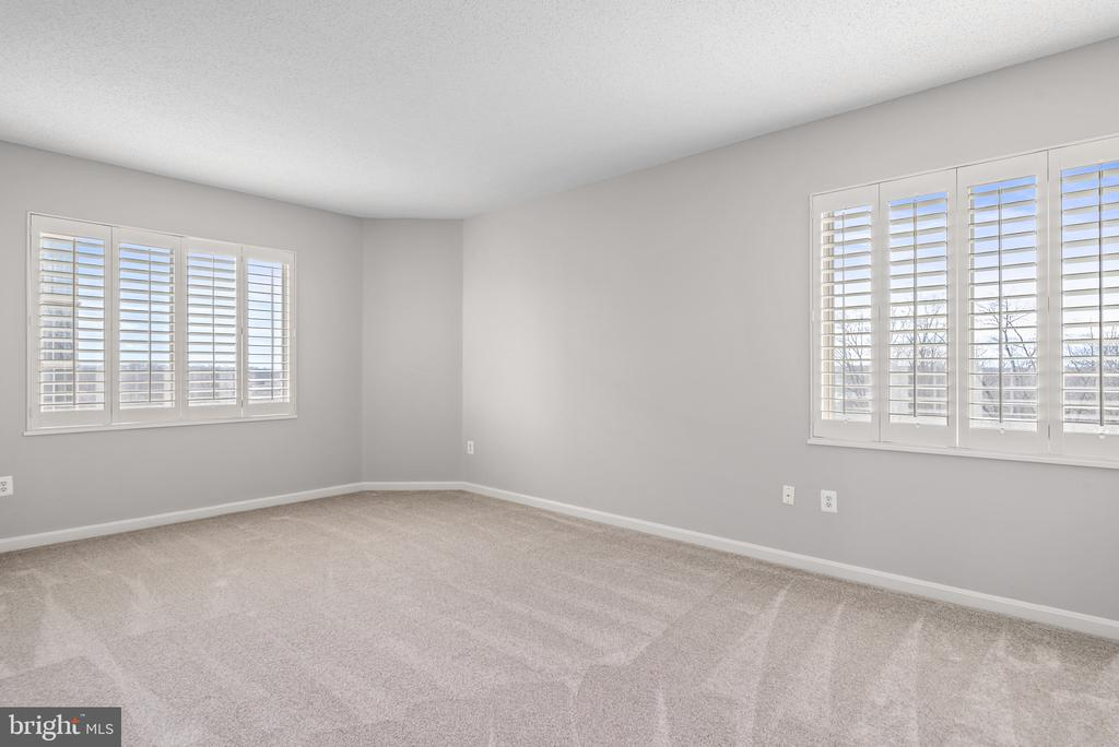 Owner's bedroom with fabulous natural light/views! - 19365 CYPRESS RIDGE TER #707, LEESBURG