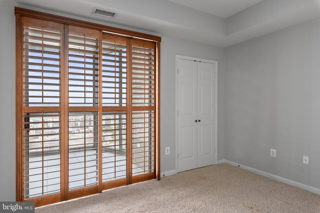 Plantation Shutters that slide open to sunroom - 19365 CYPRESS RIDGE TER #707, LEESBURG