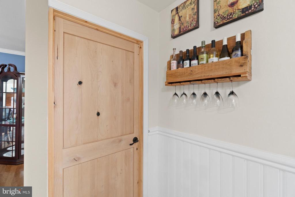 ...like this custom reclaimed wood door! - 603 S DOGWOOD ST, STERLING
