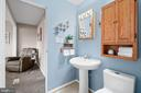 Half bath is accessible from kitchen or Bedroom 1 - 603 S DOGWOOD ST, STERLING