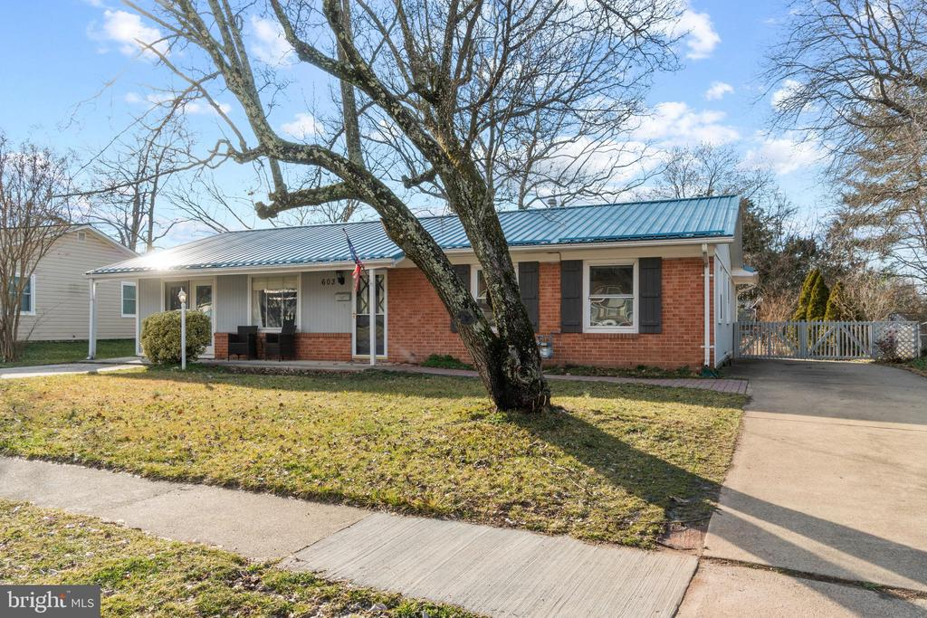 Or, you can drive down the side of the home... - 603 S DOGWOOD ST, STERLING