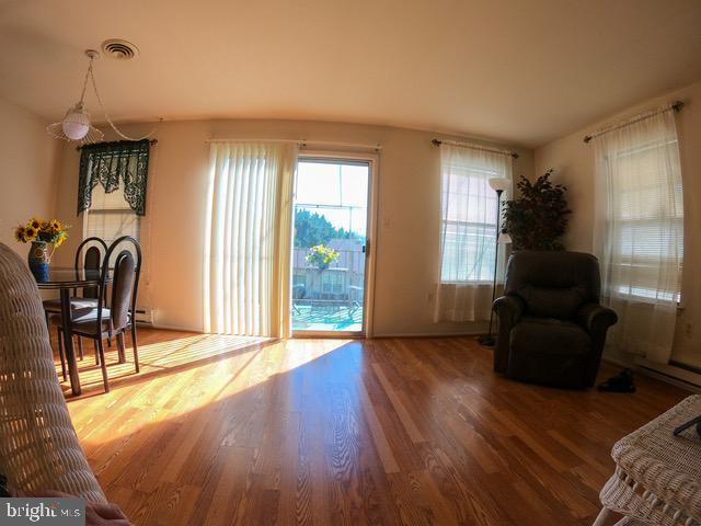 Shiny wood laminate floors - 7050 BASSWOOD RD #11, FREDERICK