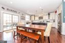 Family room opens to kitchen. - 6720 OAKRIDGE RD, NEW MARKET