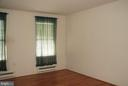 Large master bedroom also has wood laminate - 7050 BASSWOOD RD #11, FREDERICK