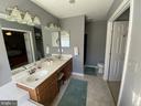Large Ensuite Master Bath w/ Tile Floor - 14103 RED ROCK CT, GAINESVILLE