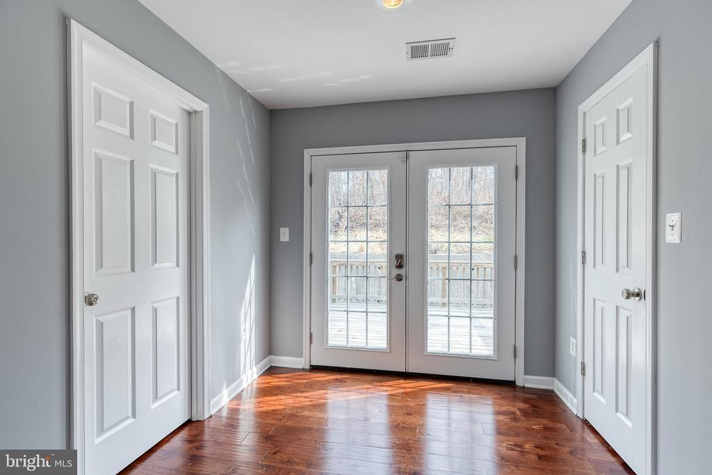 French doors lead from suite to the deck - 9011 BACKLICK RD, FORT BELVOIR