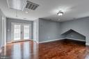 Primary bedroom with hardwood floors - 9011 BACKLICK RD, FORT BELVOIR