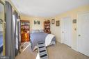 Primary bedroom with entrance to bath - 706 PINNACLE DR, STAFFORD