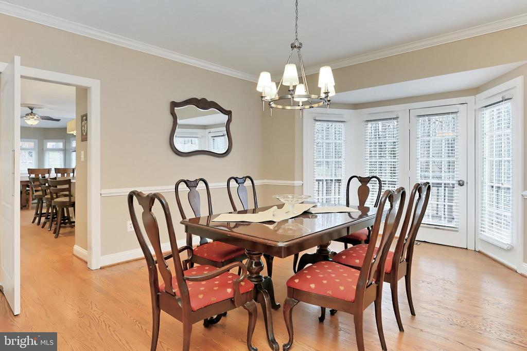 Dining Room French doors to the tiered deck - 6302 KNOLLS POND LN, FAIRFAX STATION
