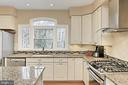 Appliances include a gas range w/ convection oven - 6302 KNOLLS POND LN, FAIRFAX STATION