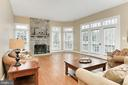 Family Room with wood-burning fireplace - 6302 KNOLLS POND LN, FAIRFAX STATION