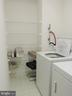 Utility Room has storage shelves - 19365 CYPRESS RIDGE TER #416, LEESBURG