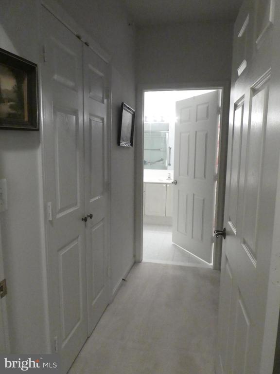 Entry to Primary BR with Walk-in closet & full BA - 19365 CYPRESS RIDGE TER #416, LEESBURG