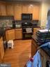 Lots of counter space and cabinets! - 19134 ROCKY CREST TER, LEESBURG