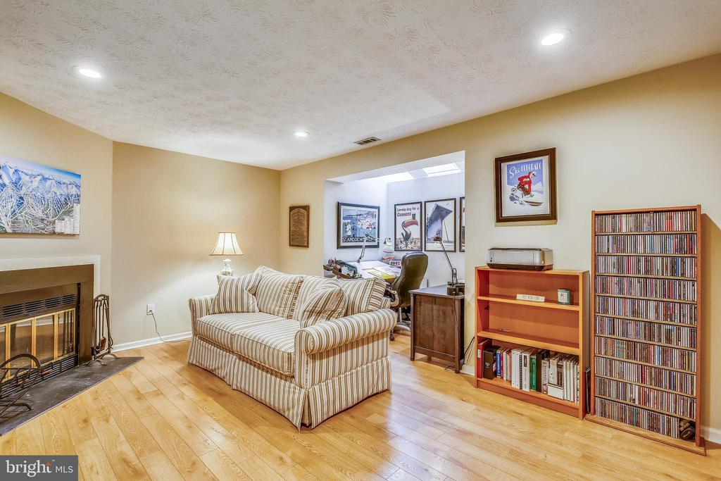 Lower level recreation room with hardwood flooring - 10828 DOUGLAS AVE, SILVER SPRING