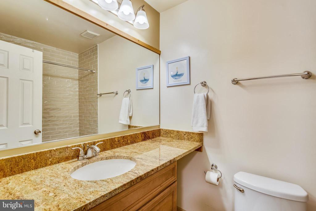 Renovated upper hall bath with granite countertop - 10828 DOUGLAS AVE, SILVER SPRING