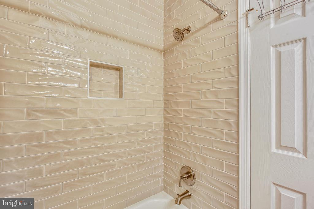 Renovated hall bath w/ subway tile tub/shower - 10828 DOUGLAS AVE, SILVER SPRING