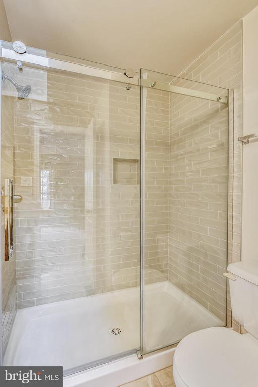 Renovated primary bath w/ tiled walk-in shower - 10828 DOUGLAS AVE, SILVER SPRING