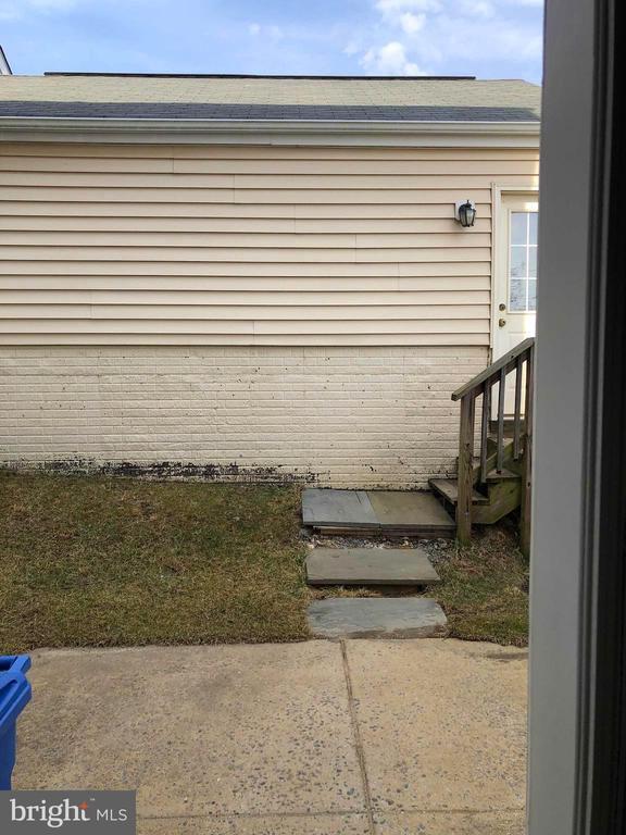 Back of garage - 23600 BENNETT CHASE DR, CLARKSBURG
